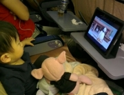 Jerry watching cartoon on ipad on the flight back from our Hong Kong vacation
